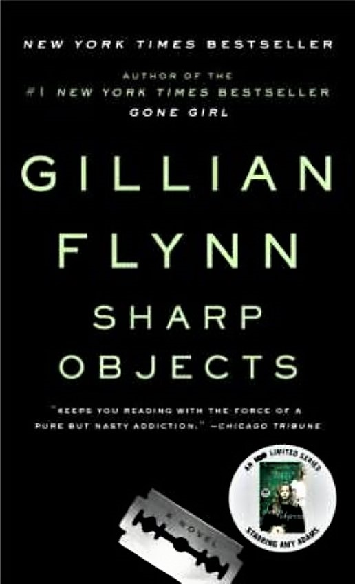 Black bookcover with a small picture of a razor blade and a circular book ad on it. Writers Arcanum - Fiction by Gillian Flynn